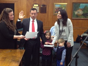 Newcomer Ian Mount, second from left, is sworn in by Township Clerk Christine Gatti, left. He is accompanied by his wife, Maria, and children Olivia, 5, and Ryan, 3.