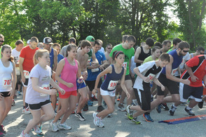 Runners move past the starting line.