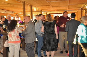 Guests enjoy the fundraiser at the Barn at Perona Farms.