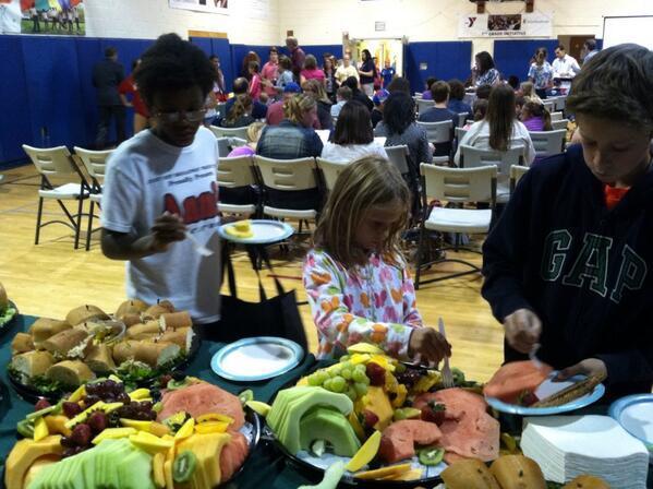 979aae4be8dfbf5a246e_Kids_eating_healthy_at_7th_Grade_Initiative_kickoff.jpg