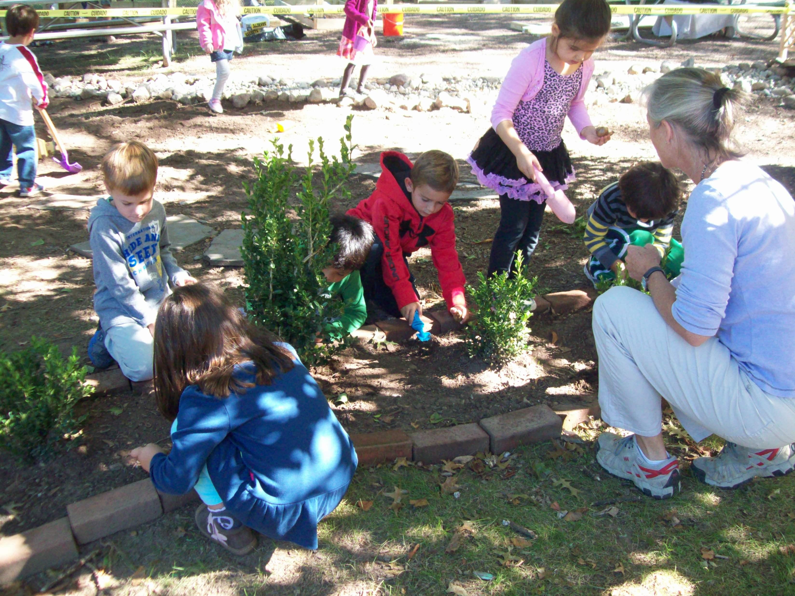 3b20c73590f53931a11c_Outdoor_Classroom_-_TSTI_Preschoolers_Planting.JPG