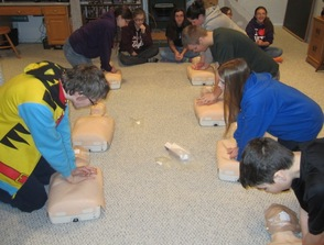 Crew 276 members practicing their newly learned CPR skills.