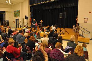 Audience members gather around Yarrow onstage.