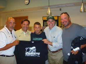 From left: Barry Kostibos, head coach; Greg Vacca, assistant coach and assistant principal; Adam Slavitt, president of LFPA; Mark Stern, principal of LHS; Bob Breschard, teacher and coach at LHS