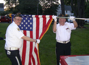 Veterans furl the flag after the Memorial Day Concert