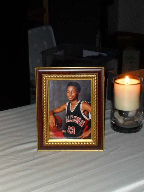 c81322bfada4242268f7_Ap_candlelight_victims_photo_with_candle.jpg