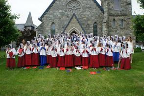 Grace Combined Choirs pose as Benjamin Britten