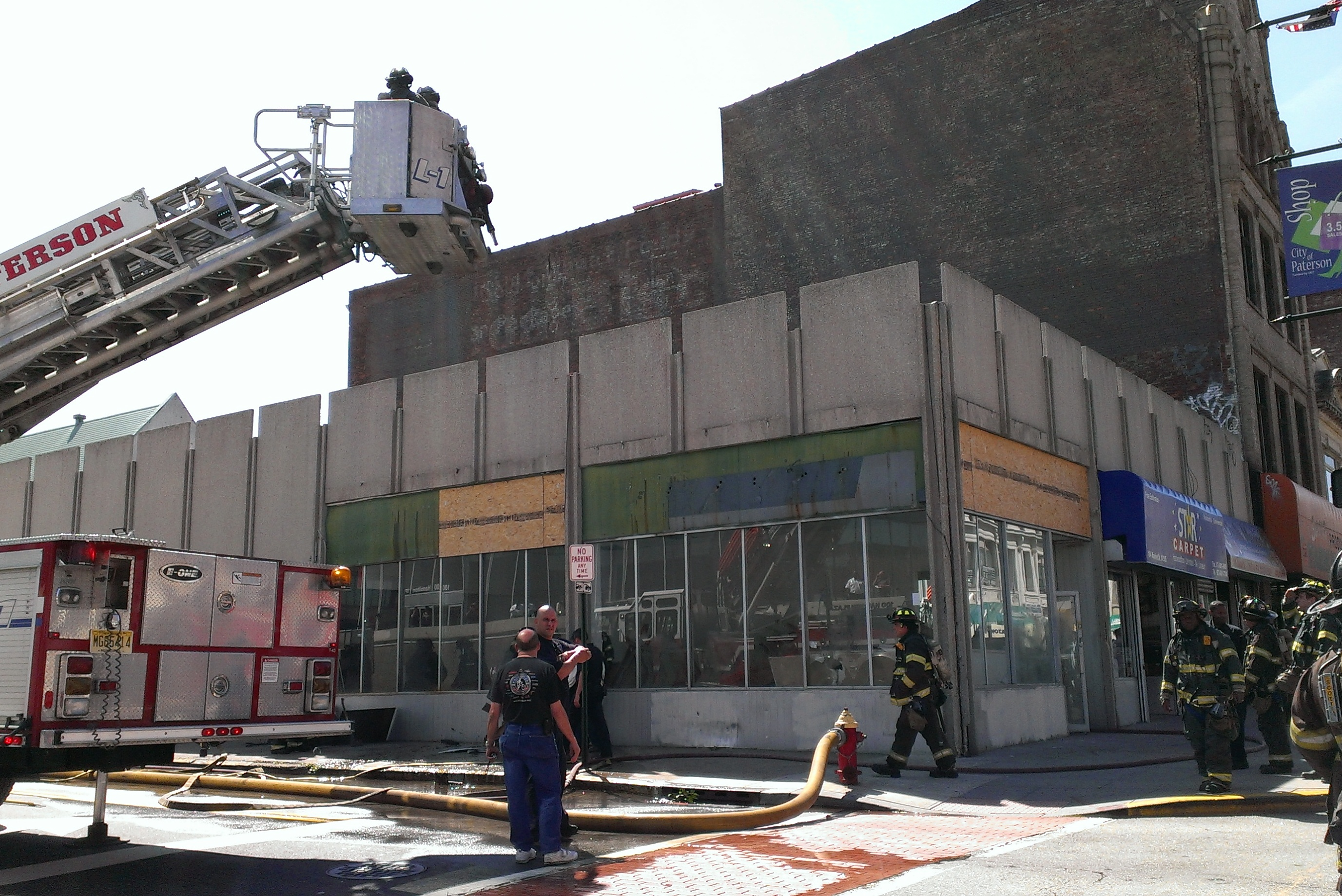Abandoned Downtown Retail Store Front Catches Fire