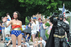 Wonder Woman walks alongside Batman.