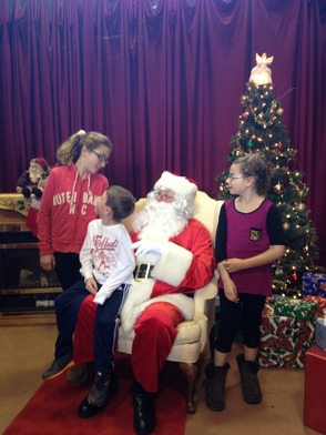 Abbey, James and Sadie Miller with Santa