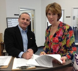 Bader Qarmout submits his petition to the Sussex County Clerk's Office, and is pictured with Deputy County Clerk, Angela Rosa.