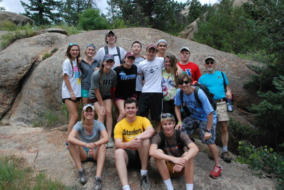 5c12e31eb67580a7902b_Amanda_with_one_of_the_groups_that_took_a_hike_to_Gem_Lake_part_of_Rocky_Mountain_National_Park_on_the_Free_Day.jpg