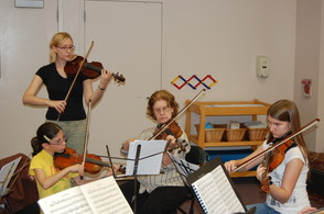 Coaches work closely with their musicians in the NJIO Spring Strings Studio