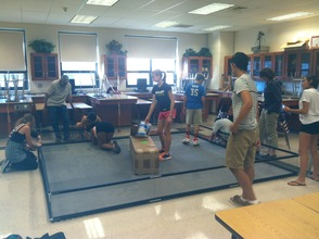 Chatham Robotics Team Members setting up the Practice field for the first practice of the season