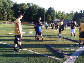 WHRHS Football Players demonstrating skills for younger players