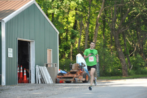 Louie Stengel, overall 5K winner, heads in at end of the race.