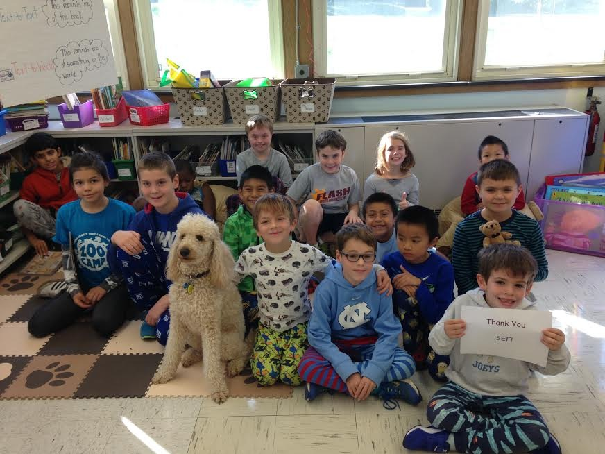 Canine Tutor Gives Lincoln-Hubbard Students Added Confidence to Read Aloud