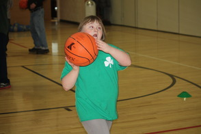 Mary Shoots Basketball