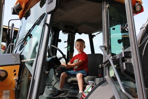 Aidan in his Dad's Back Hoe