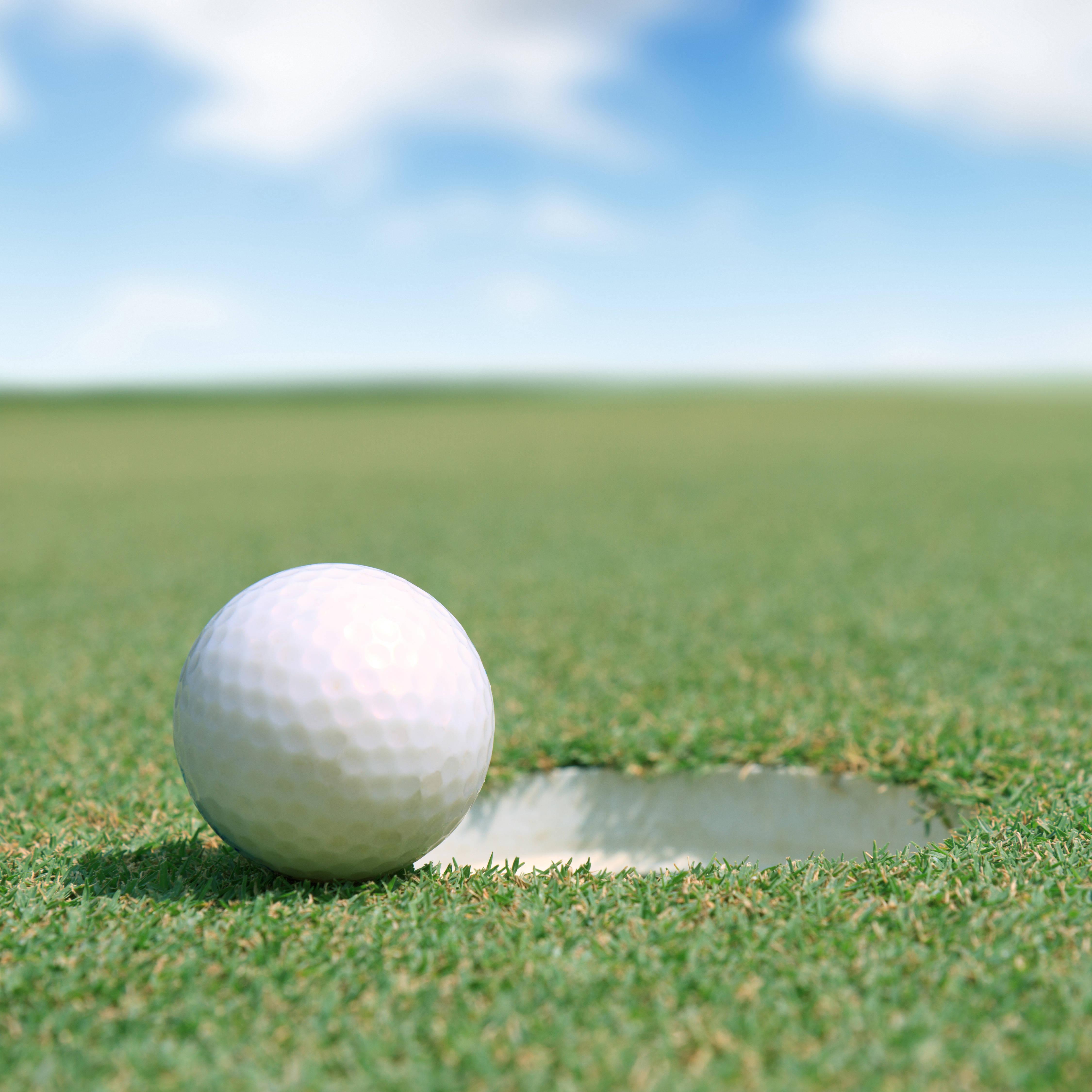 02a36cebd31f3eb6bf6b_Golf_ball_at_hole_photo.jpg