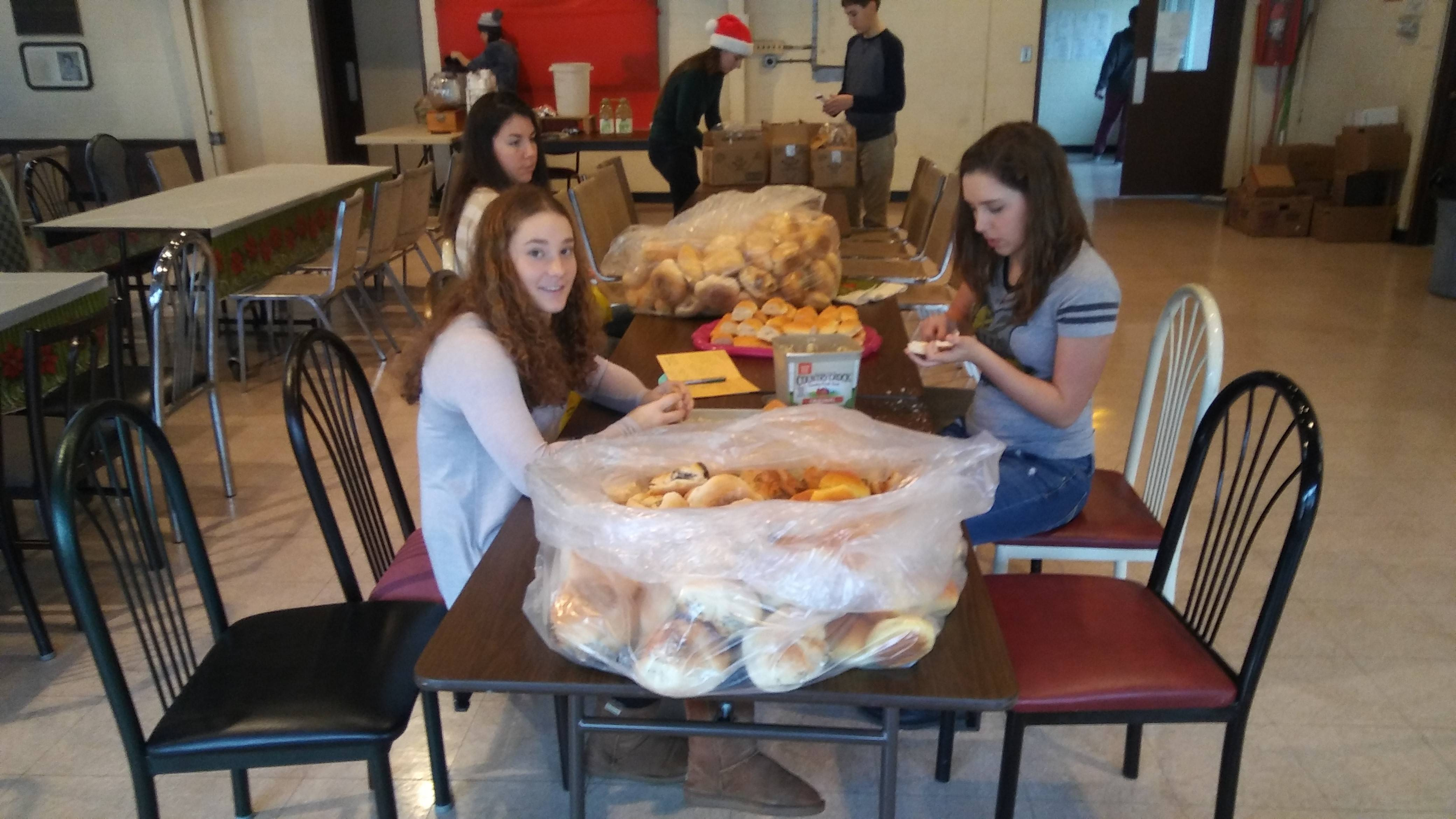 06129b6b396337141d68_The_First_Pres_Cranford_Youth_Group_buttering_bread_for_dinner.jpg