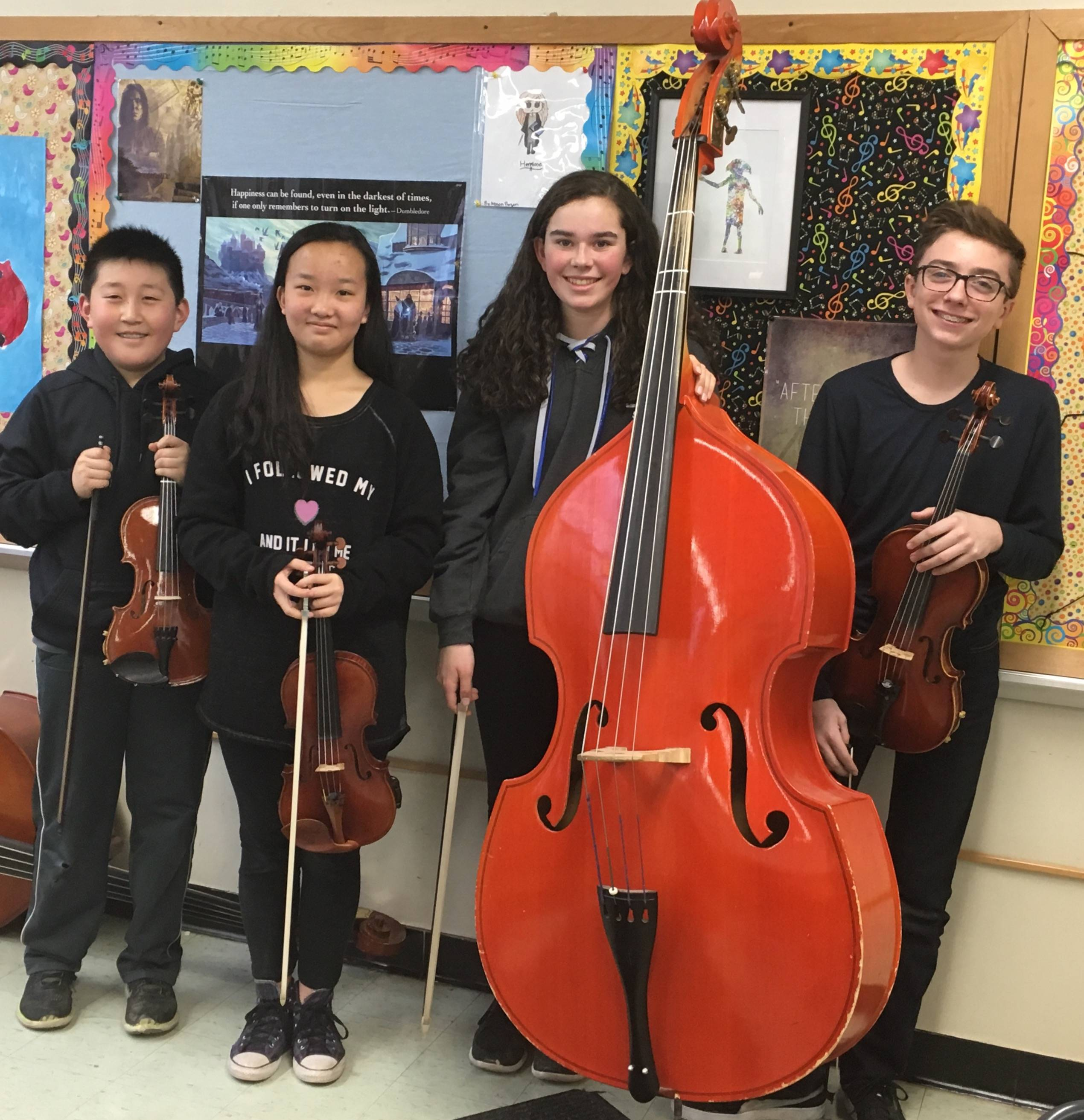 0b57478571438932de2a_EIS_All_State_Intermediate_Orchestra_members.jpg