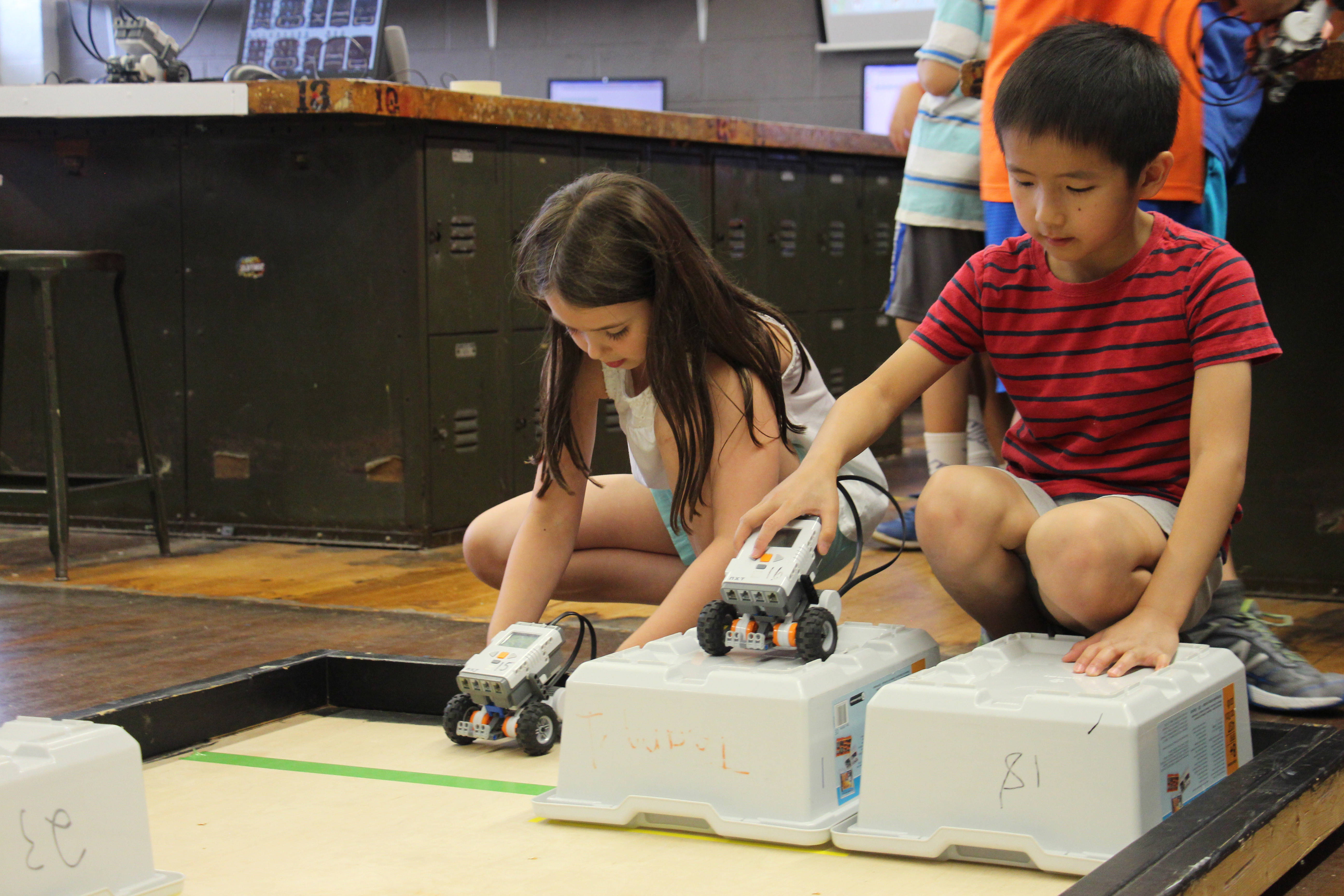 0bbd75a269d88ea6ad21_Girl_and_Boy_with_robot_STEM_Camp.jpg
