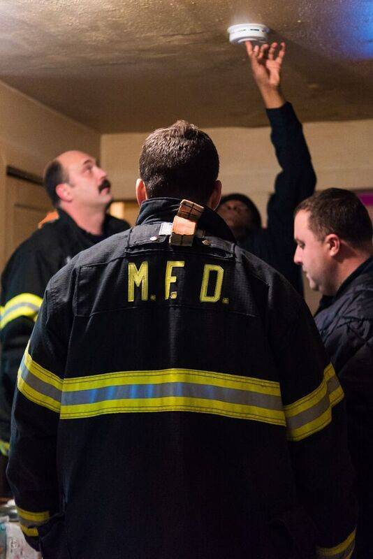 11d5ab767a567ed00842_Firefighters_Install_Smoke_Detector.jpg