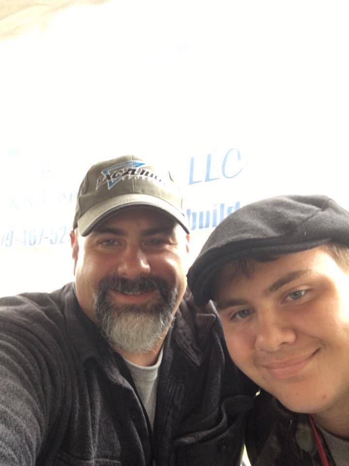 168b4a7354d67688ec96_1da44cd4a44a2dc775c6_PKR_Contstruction_Paul_and_Youngest_Son__Alex_Rueda_Manning_their_Booth_at_Merchant_Mart.jpg