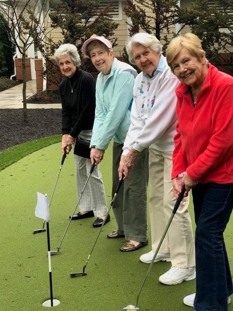 19787895c72534b08160_Lantern_Hill_Chris_with_Women_Golfers.jpg