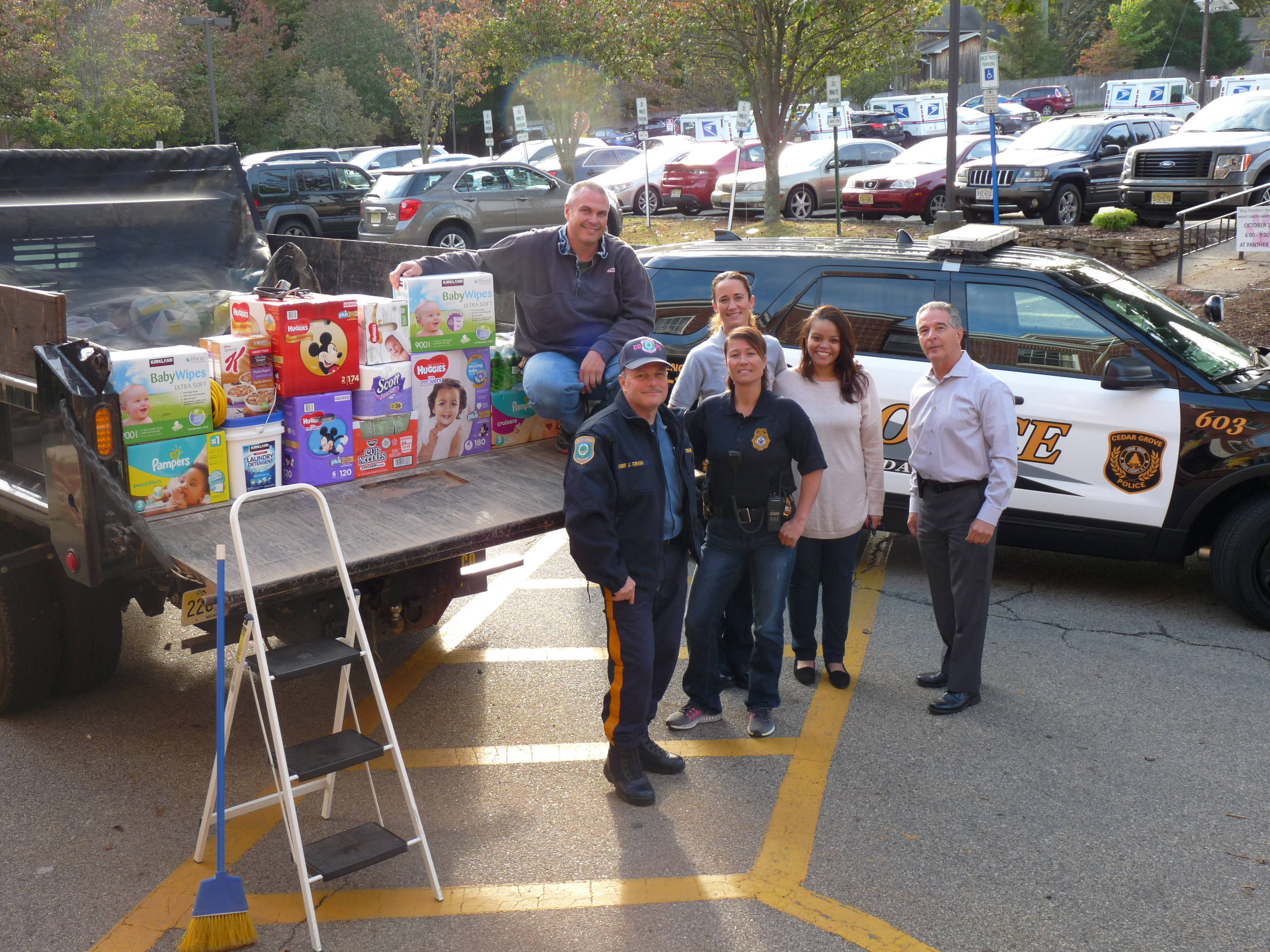 photo of the day cedar grove collects donations for victims of