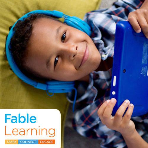 3797eb84f4c504b64ea0_Fable-Learning-boy_blue_headphones-500x500.jpg