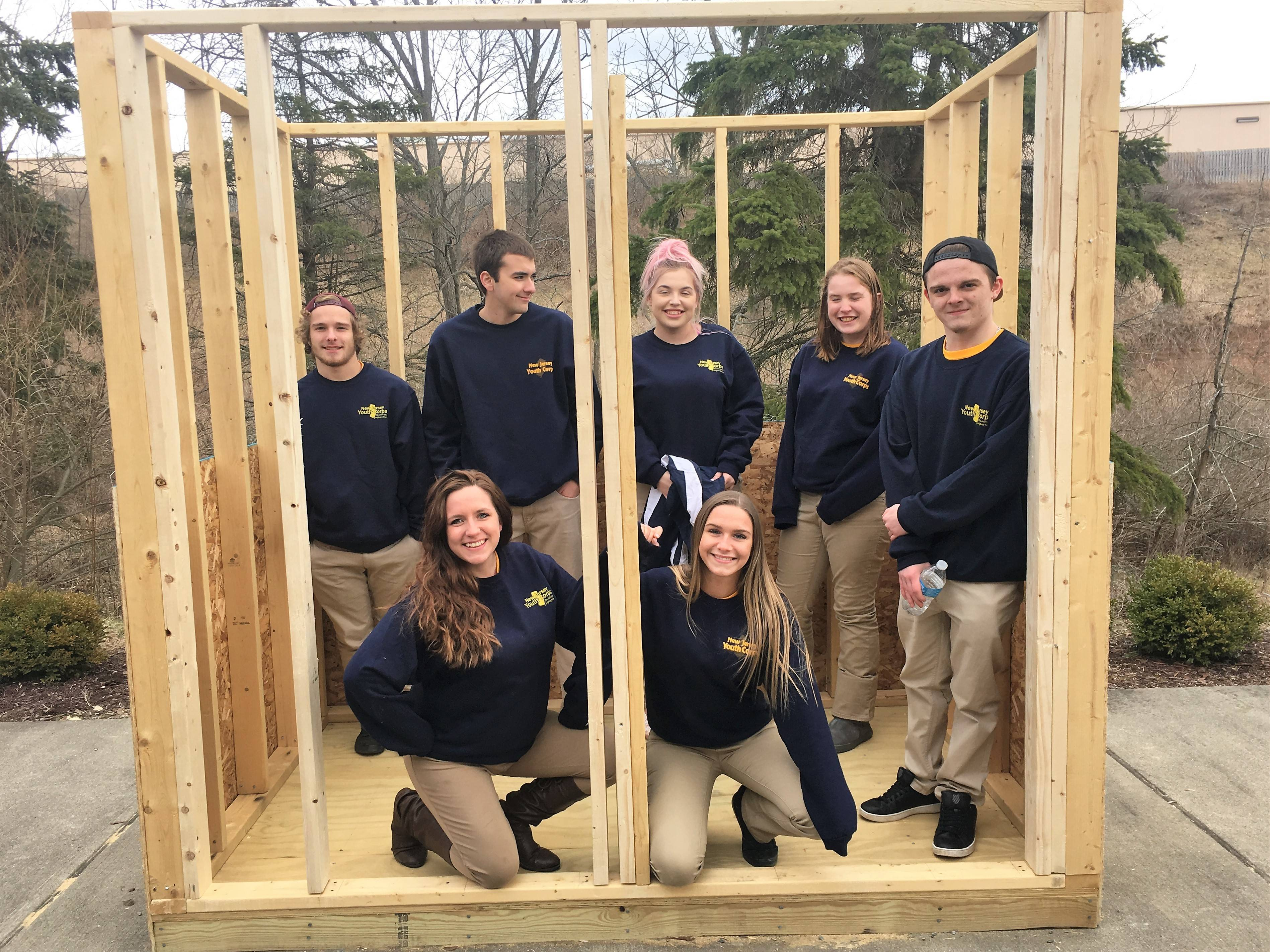 3ca19d6f3a28229fb0ae_NJYC_Students_Building_Sheds.jpg