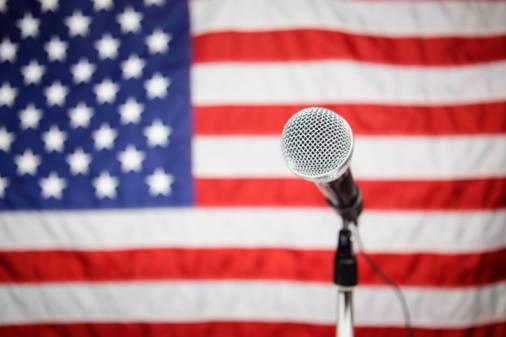 4075e216913b9f56b1e2_8b5e562e077a00d2bedb_20130227_first_amendment_microphone_usa_flag_large.jpg