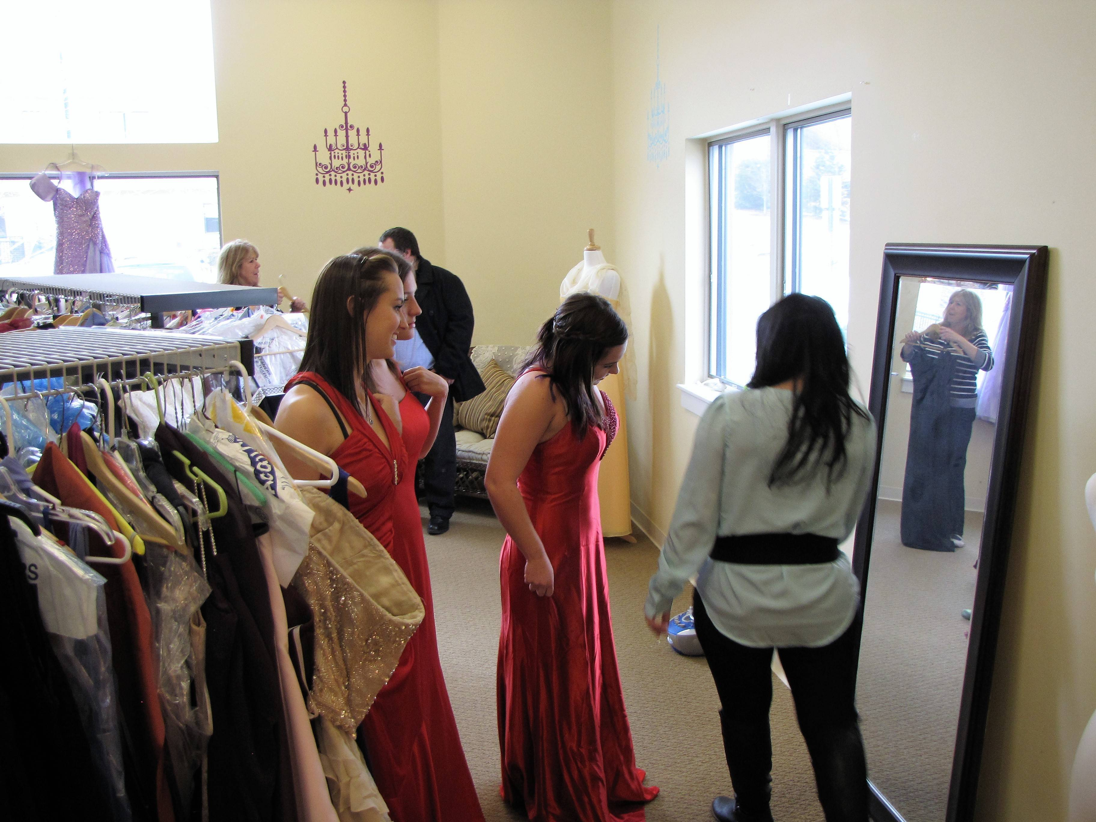4081cdfa87189f4e0f88_Teen_girls_try_on_prom_dresses_at_the_Sister_to_Sister_Prom_Shop.JPG