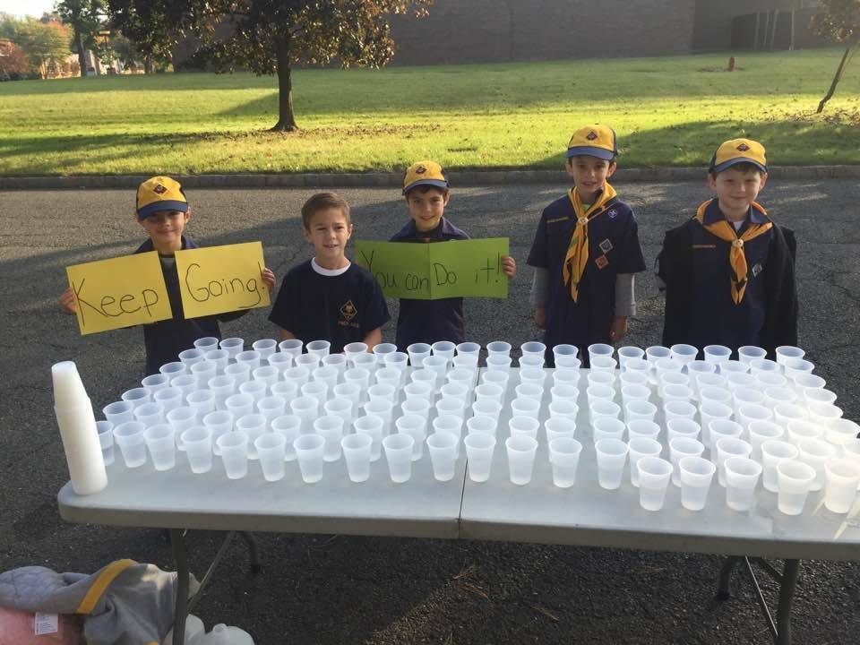 492948cdbd73eaf5385c_Cub_Scouts_supporting_runners_in_the_NPEF_s_Strides_for_Students_5K_event..jpg