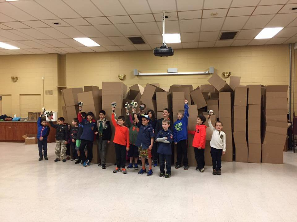 49eab7cc73b4939236ff_Cub_Scouts_from_Pack_263_after_a_night_of_taping_boxes_to_accept_food_donations_for_the_Scouting_for_Food_Drive..jpg