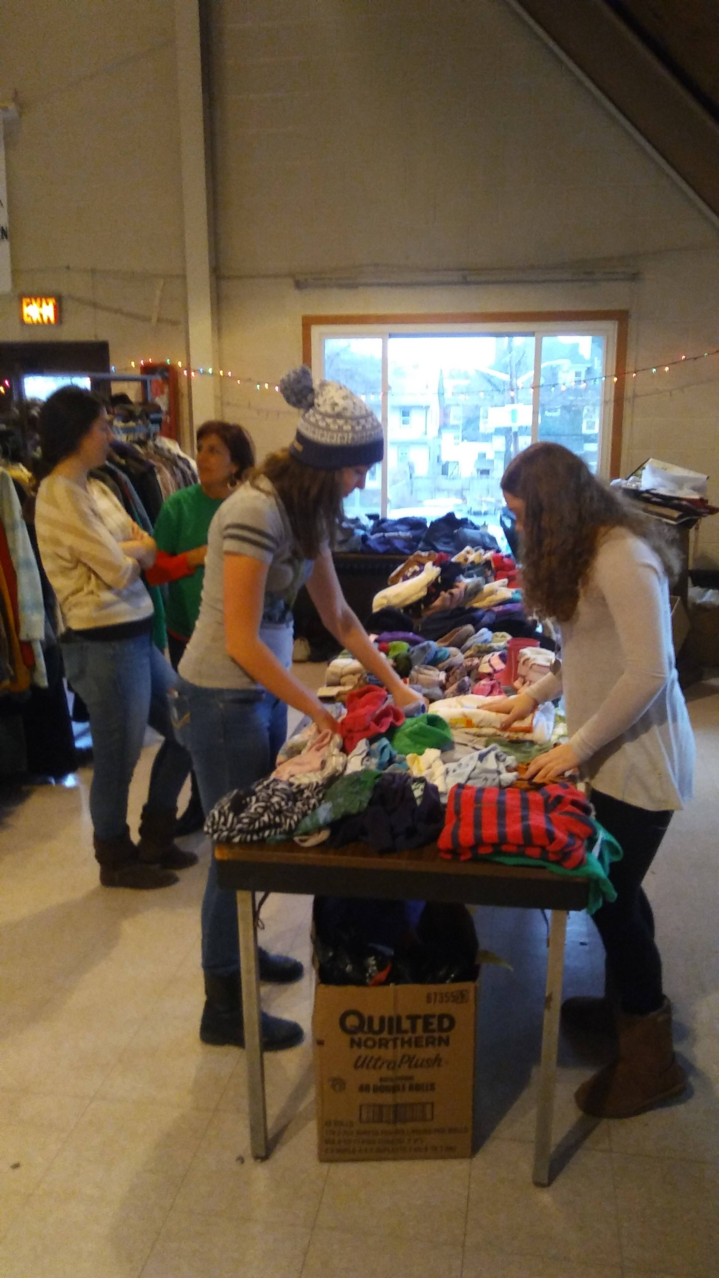 4ccfeea02b9130017352_The_First_Pres_Cranford_Youth_Group_sorting_through_donated_clothing.jpg