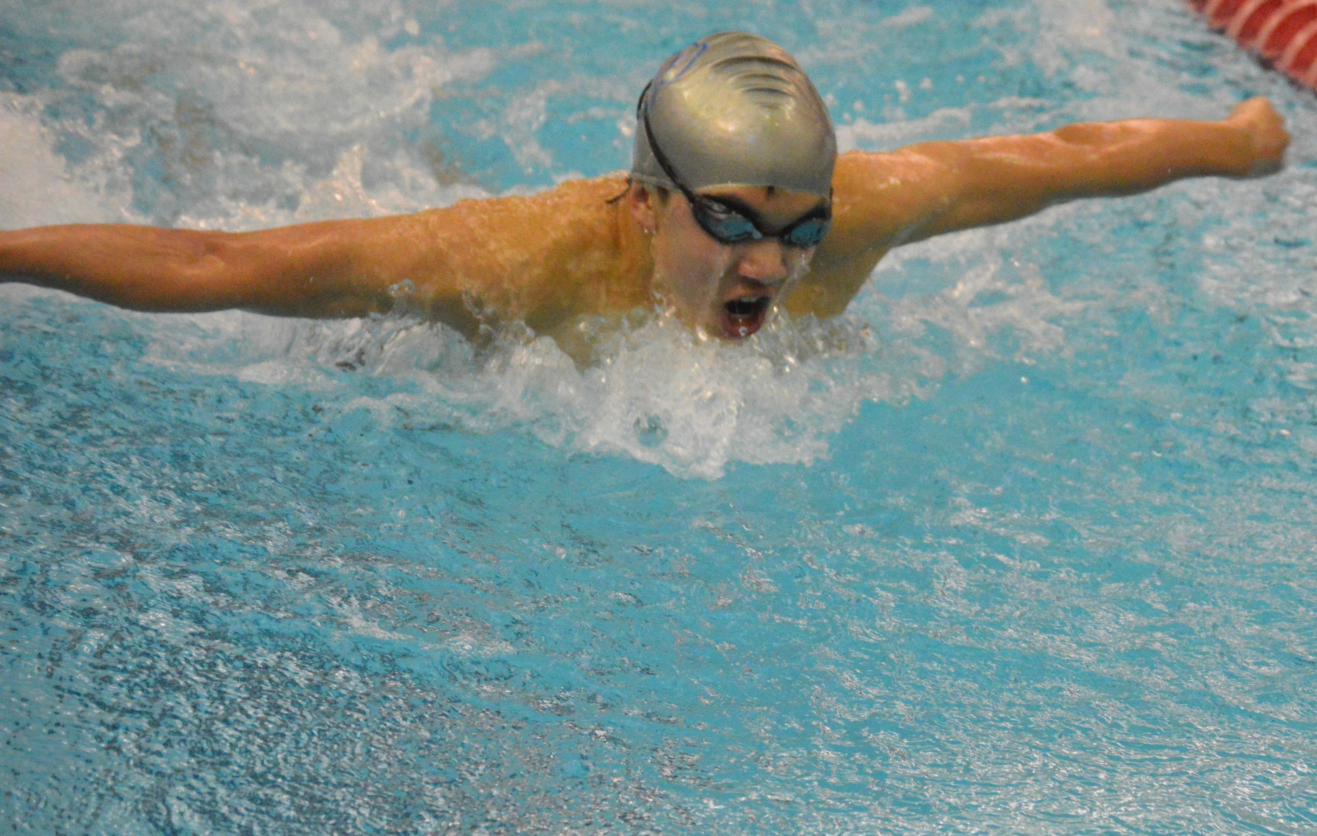 550ca30afab4e6805be9_1-18-17_Alan_Shao_wins_the_100_Butterfly.JPG