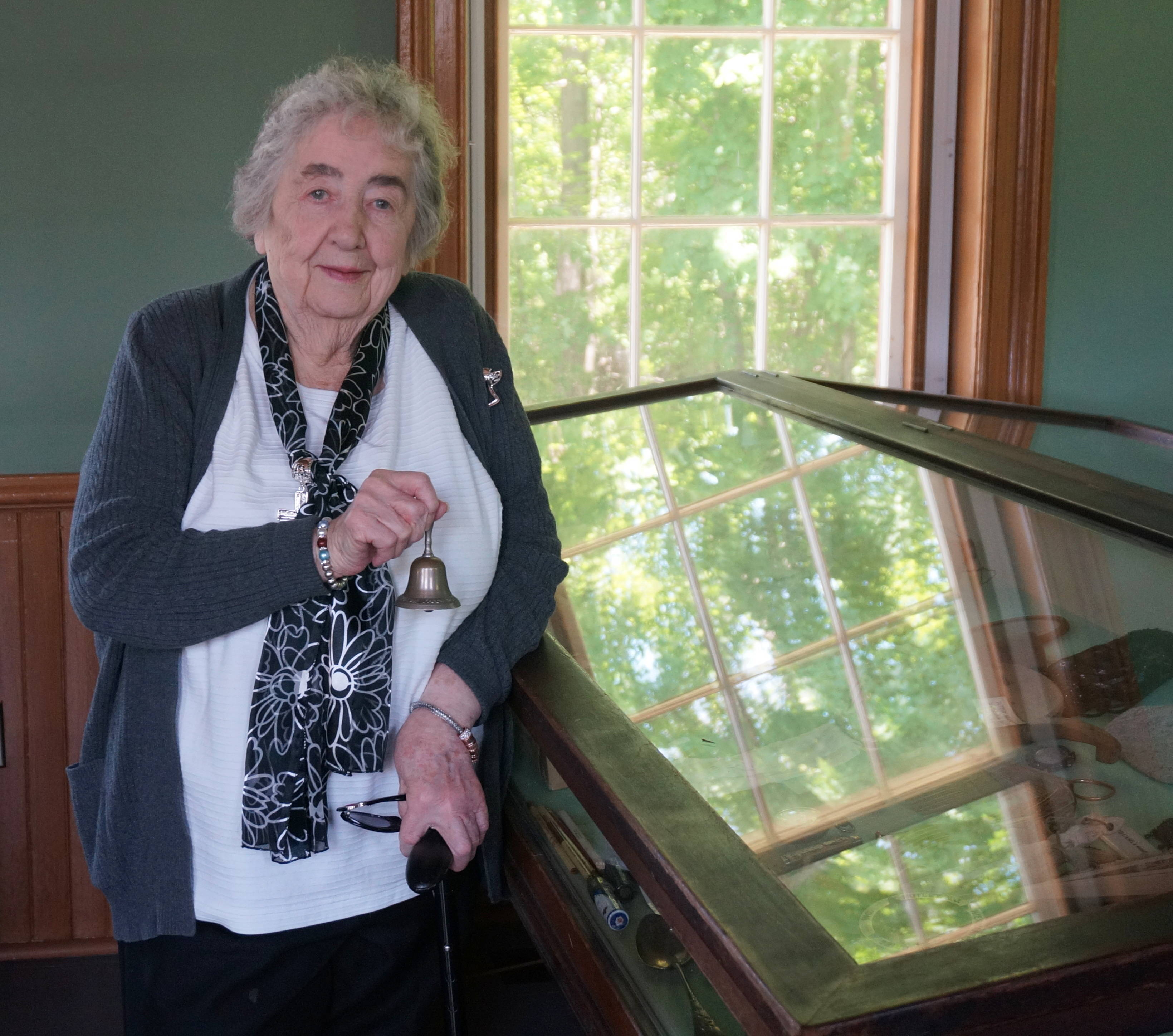 58f5f0114b18fbc65c71_a_Ginny_Cook_holds_a_mini_bell_from_the_Montville_Reformed_Church.JPG