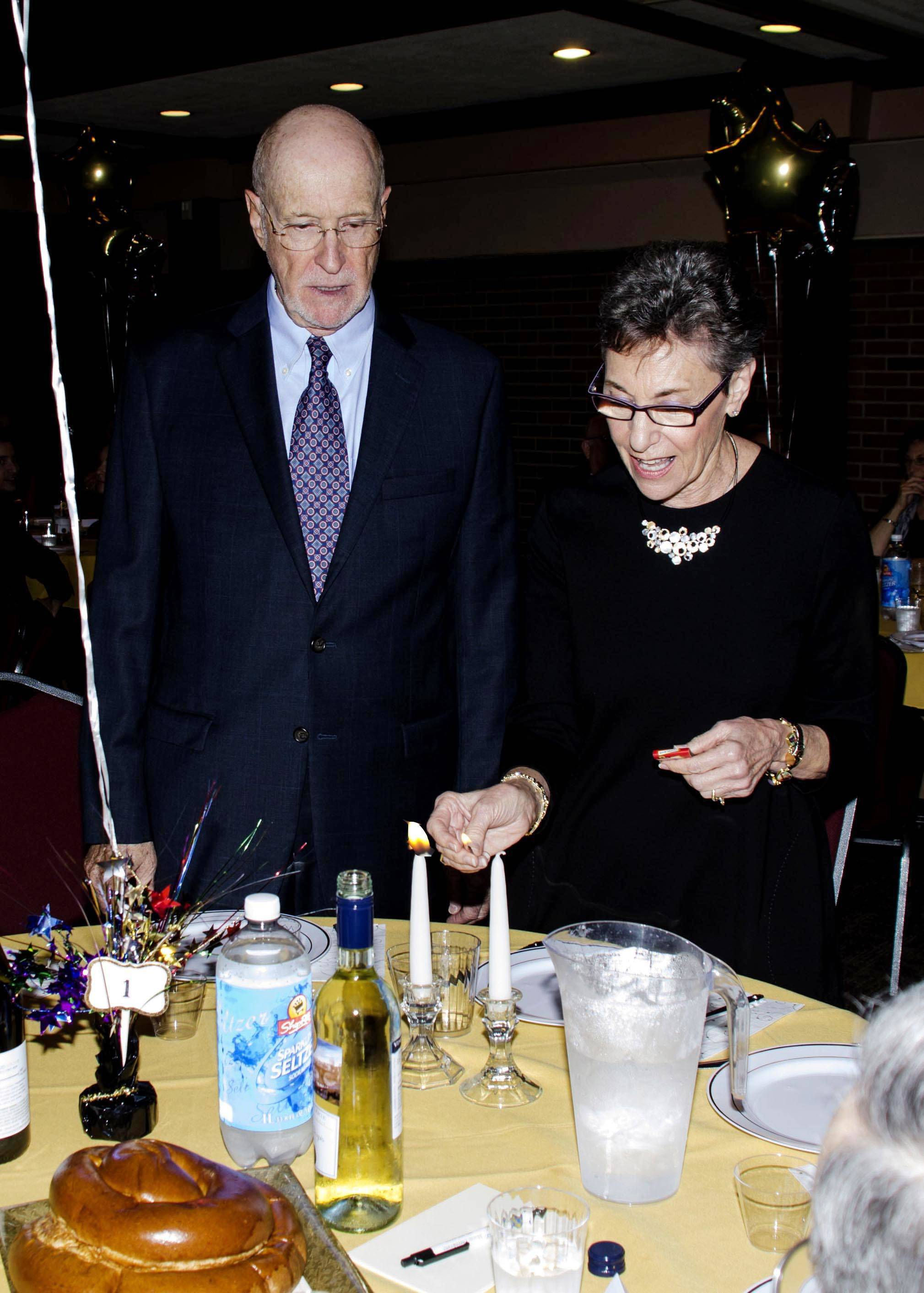 62d01dfd99d20d320256_Rabbi_Sheila_candles.jpg