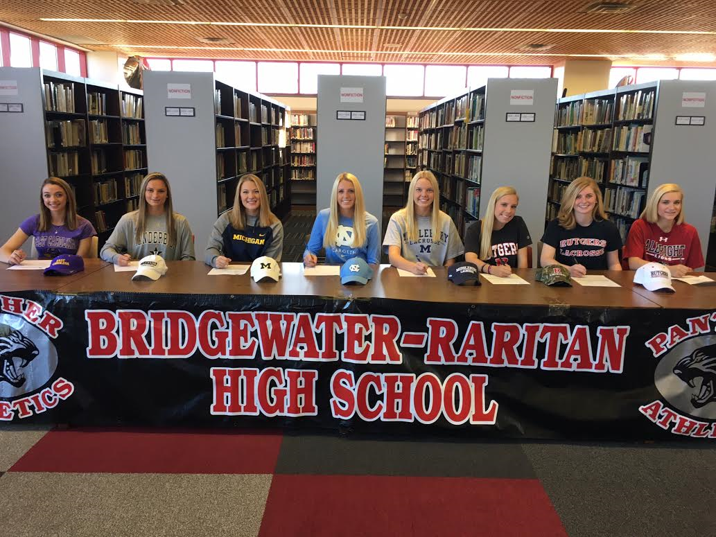 6452129a7f25798824f3_girls_lacrosse_signing.jpg