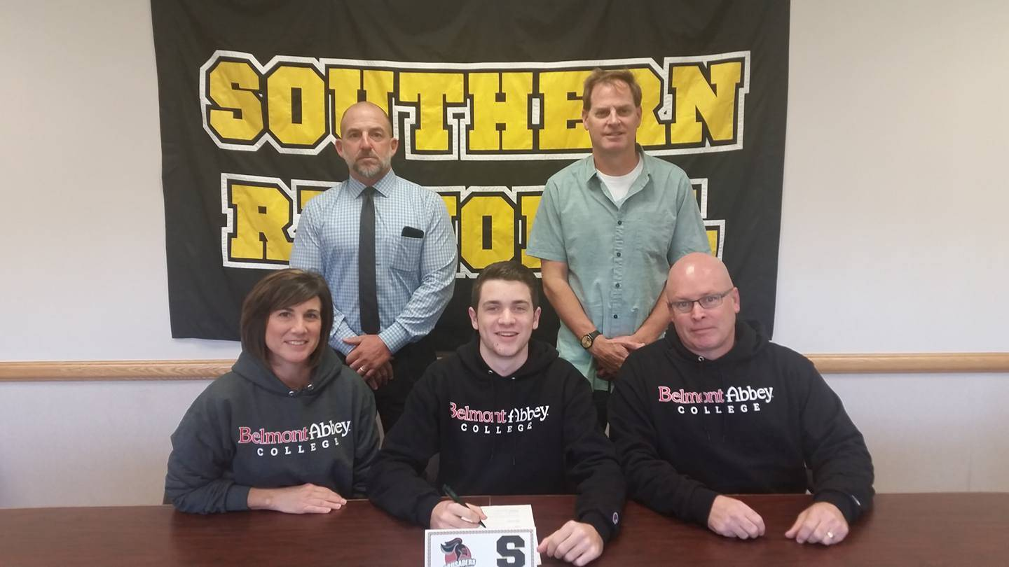 727231f4e9ab58525794_Collin_Lockwood_SIGNS_with_Belmont_abbey.jpg