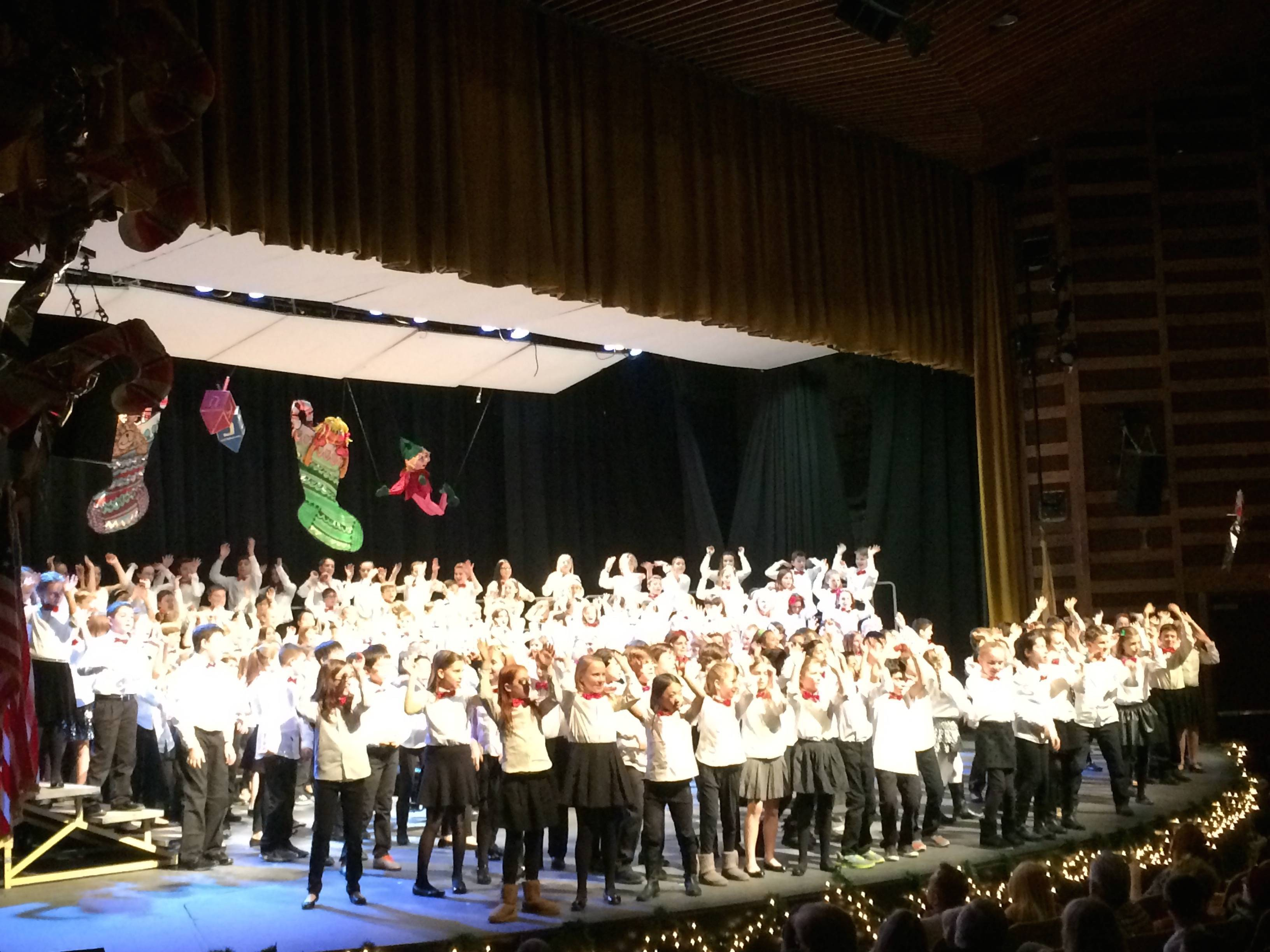 78813782d45d827d2778_The_5th_grade_performers_join_together_for_the_finale__their_performance_of__Santa_Claus_Boogie__under_the_direction_of_Dean_Kravitz.jpg