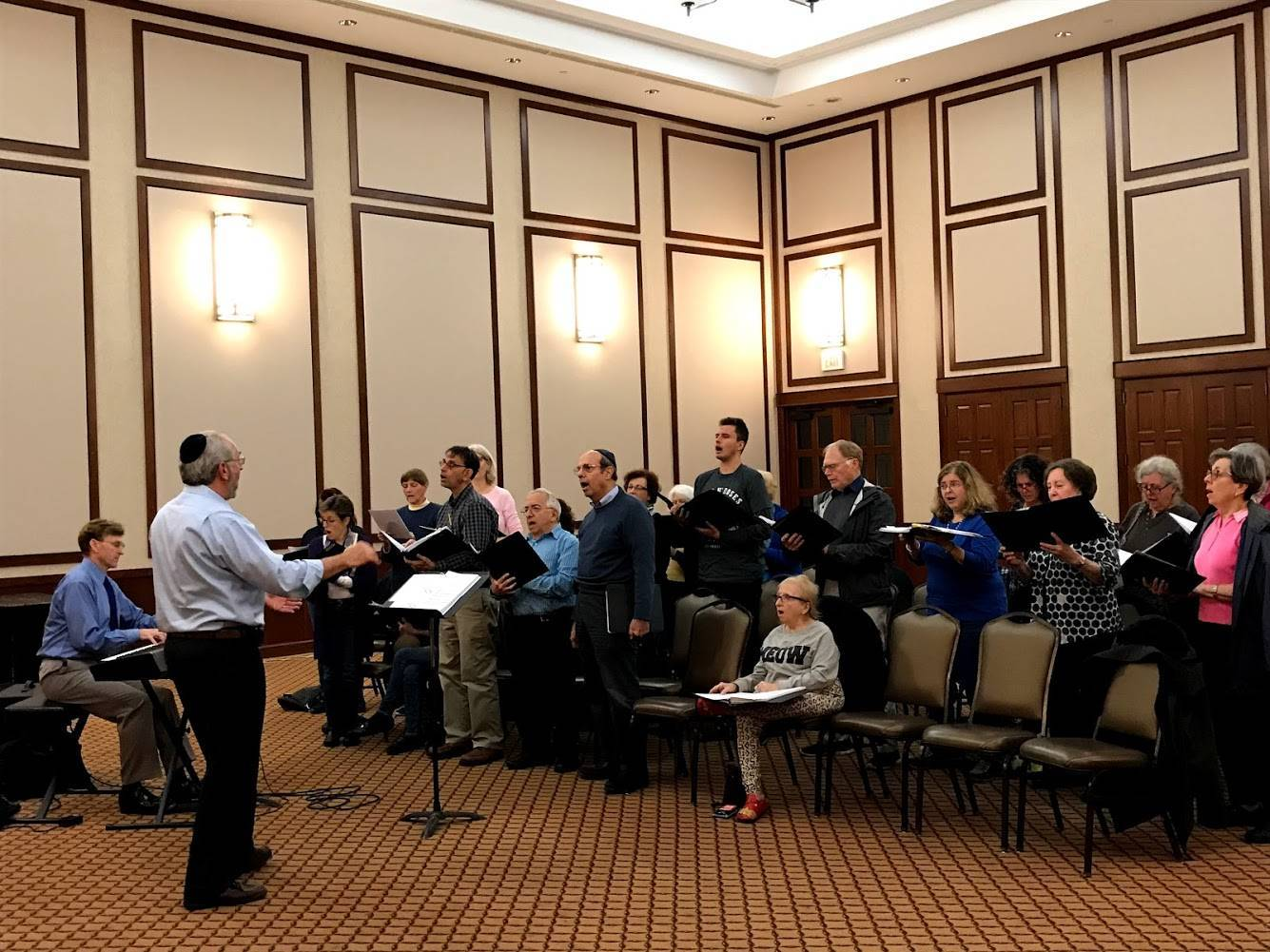 87553a14a9498e507f09_Cantor_Perry_Fine_leading_a_rehearsal_of_the_Voices_of_Harmony_Interfaith_Chorus.jpg