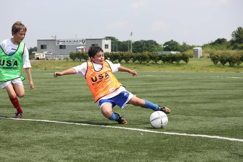 884f8e24f79e6d6043e4_kid_soccer_picture.jpg