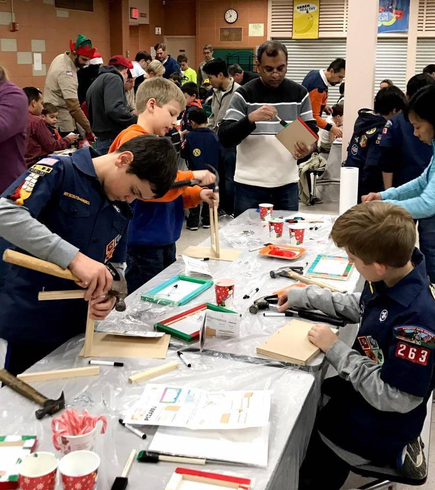 8e10084d4b5a385b0c7e_Cub_Scouts_and_parents_spent_their_evening_building_and_painting_toys_and_decorations_to_donate_throughout_the_community..jpg