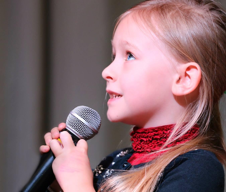 8ed8c7e0753ab2c2fdb2_child_singing-1804148_1920_-_Edited.jpg