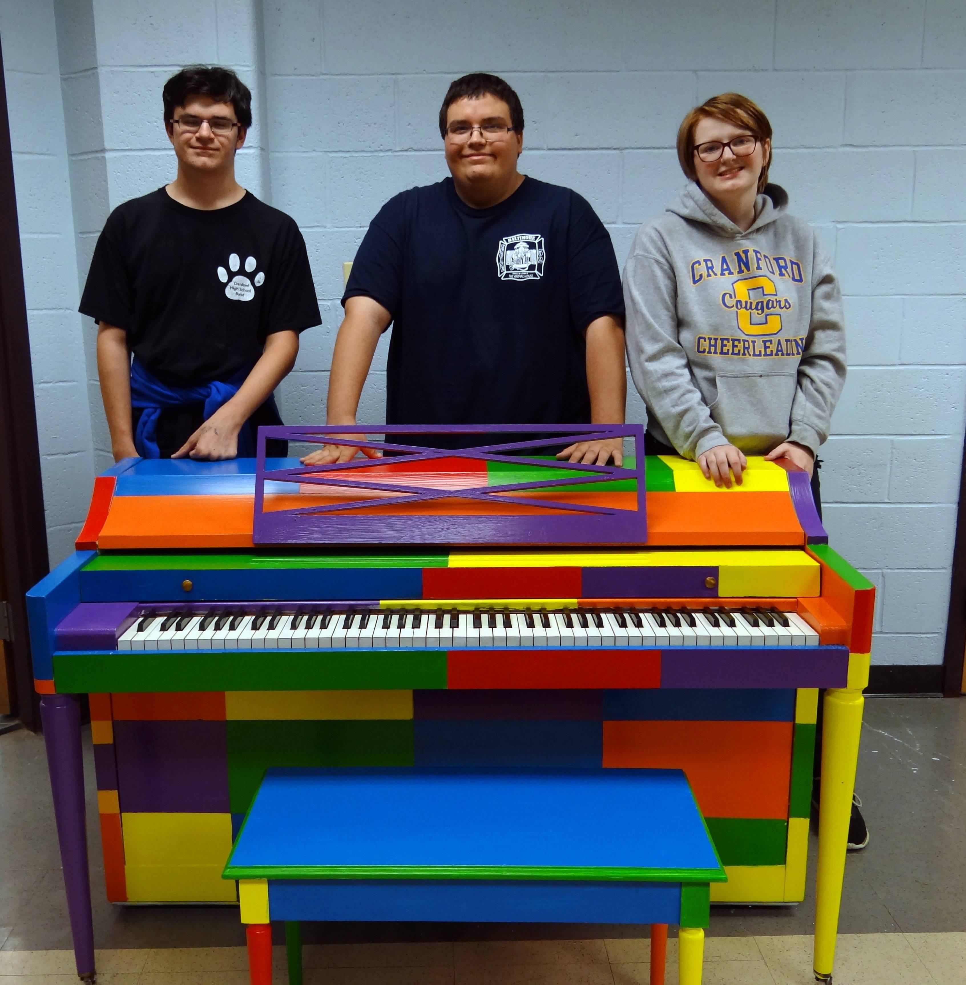 9377c847727f5ef9e10c_Robert_Ben_and_Erin_with_piano.JPG