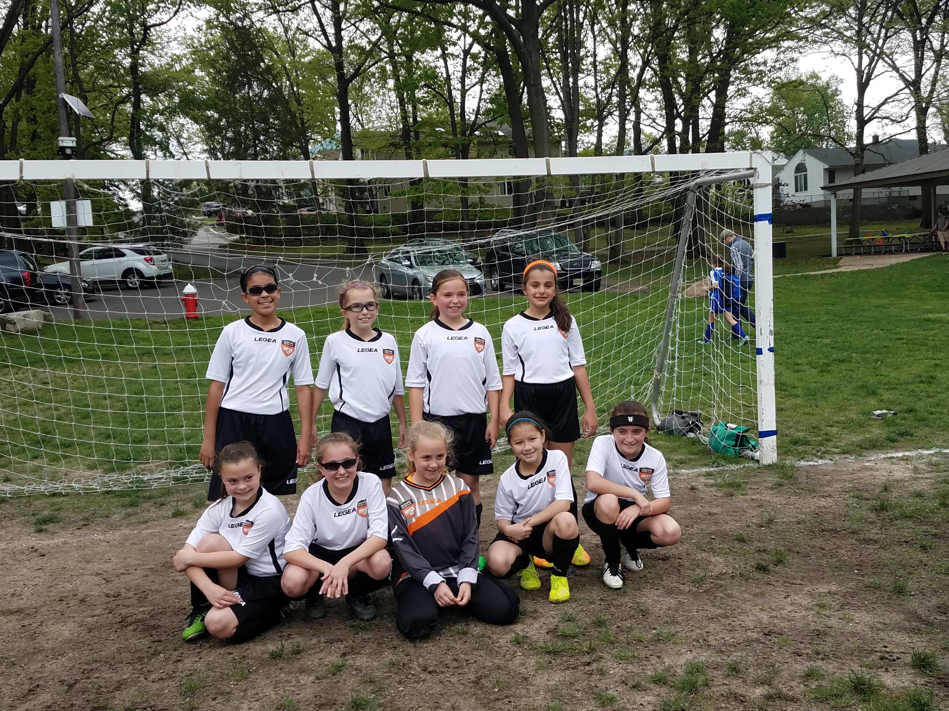 94c331f74c97d64e80c0_u10_girls_travel_soccer_team.jpg